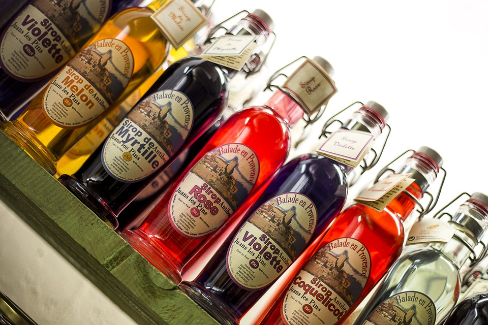 different flavors of syrups in bottles