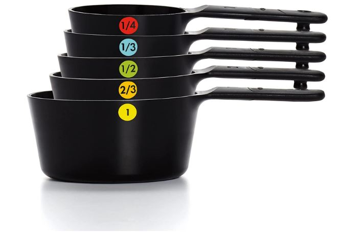 5 black plastic measuring cups stacked on top of each other